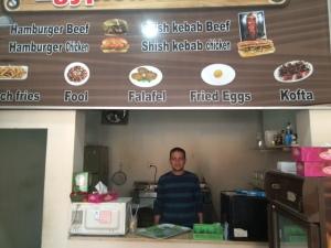 Mostafa inside his small Kitchen